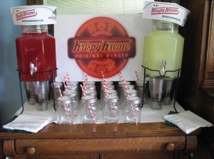 This was our drink buffet. I bought the plastic cups from Krispy Kreme. For the mason jars I used white paper with green dots. Then I punched a hole in them for the red striped paper straws. The sign was made by staples. I googled Krispy Kreme images and found 2 I liked. Then they put them on the boards.